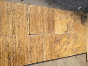Cross and vein cut yellow travertine